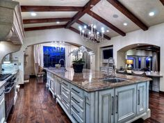 You can whip up just about anything in this no-expense-spared kitchen. Chef-grade appliances blend beautifully with elegantly rustic architectural details such as the solid hand-hewn and distressed ceiling beams and solid white oak hand-distressed floors. Elegant Kitchens, Luxury Kitchens, Beautiful Kitchens, Dream Kitchens, Luxury Estate, Luxury Homes, Contemporary Family Rooms, Hgtv Kitchens, Luxury Portfolio