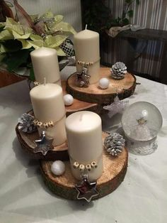 noel design Christmas centerpiece with wooden logs . Log Centerpieces, Centerpiece Christmas, Christmas Candle, Christmas Home, Christmas Crafts, Christmas Decorations, Xmas, Christmas Ornaments, Advent Wreath