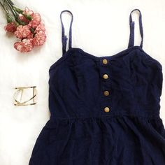 Navy Chambray Dress with Metallic Buttons 🌿HP🌿 Style Crush 4/17/16 Summer Staples 6/20/16 Help Get to PoshFest 7/12/16  Navy Chambray Summer Dress with Metallic Buttons and open back. This dress is a perfect summer dress with metallic accents and a cutout back.  🌿 Open to offers 🌿 No trades 🌿 Smoke & pet free home Boutique Dresses Mini