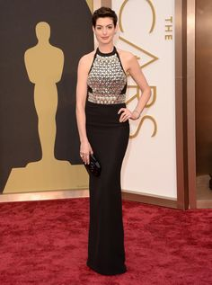 Anne Hathaway is delivering a smidgen of deja vu. The Academy Award winner wore a similar silhouette last year when she donned a pale pink halter to the Oscars -- but we much prefer this edgier studded Gucci version.