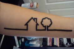 minimalist tattoo of a tree and a house