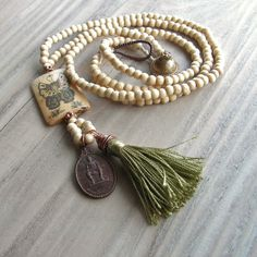 Mala Tassel Necklace in Cream Wood with Chartreuse Green Tassel and Buddhist Amulet Pendant