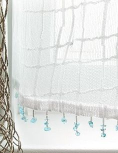 Sea Splash Sheer Curtains Delicately sheer, white panels are fringed with clear aqua sea glass as if just splashed by the sea, to create the perfect beach cottage window curtains. #Beach House Decor