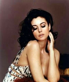 Monica Bellucci.  I know,  I keep pinning her.   But DAMN