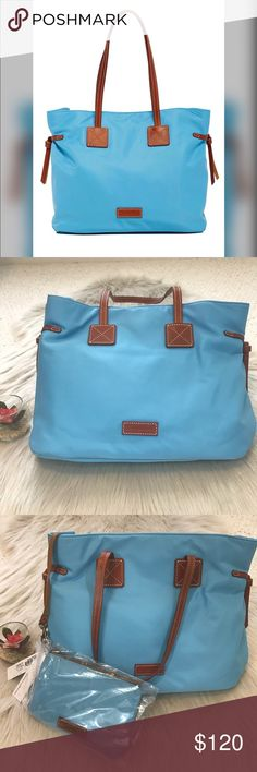 ⚡️NWT Dooney & Bourke Nylon Tote⚡️ NWT Dooney & Bourke Nylon light blue Shopper Tote with Pouch. Never used with Original tags. Bag has beautiful red interior lining. Dooney & Bourke Bags Totes