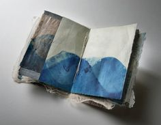 Yuko Kimura - Book Art Projects Sample Book, indigo dye, persimmon dye, etching, aquatint, copper etching foil, Kozo Bark fiber, abaca, kozo, denim- handmade paper, worm eaten old bookpages from Japan, paper thread 10 x 7 x 0.5 in, private collection