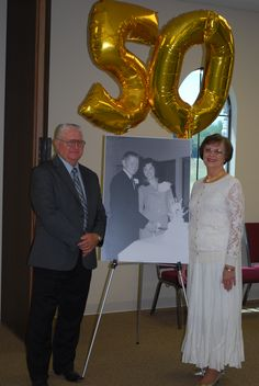 """50th Wedding Anniversary Reception, this was my favorite thing, HUGE bang for our buck!  Office Depot made """"Enginnering print"""" & mounted for $17.08, balloons ordered fr. Party City"""