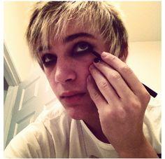 Applying some eyeliner