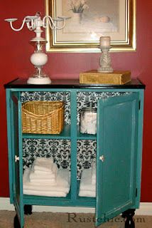 I LOOOVE this cabinet!!! The teal, the black and white pattern... everything.