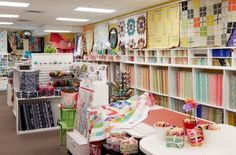 An imaginative oasisthat dazzles with clever displaysand bright fabrics encourages quilters to continue acreative legacy at Millie P's in Minnesota.