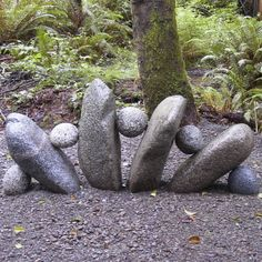 Rock garden - little things like this are so simple & add personality to a yard. I like these little guys.