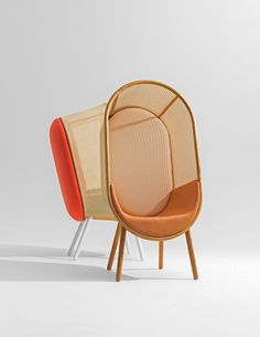 """Cocoon lounge"" by Kevin Haviid and Martin Kechayas. It has created a modernism of lounge chair for both private and public spaces. Beauty in rattan fabric and a curvy, unified wood silhouette""."