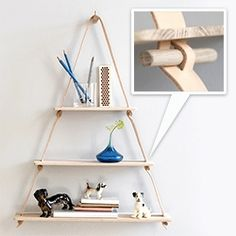by Wirth's leather and oak triangular wall shelf - love the detail of how the pegs fitted through slits in the leather keep the shelves from slipping.