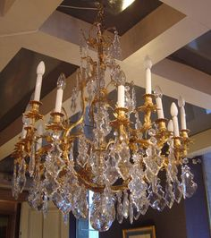 Very fine and rare French, Louis XV period chandelier.  In solid bronze d'ore with original mercury gilding and original cut crystal. Circa 1750.  Provenance: From the chapel of Chateau de Sarthe.