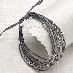 Inspiration photo - LOVE THE GRAYS! Beaded Bracelet More my idea is to add name(s) with alphabet beads to each string with a few strings before and after the names for depth. Leather Jewelry, Wire Jewelry, Jewelry Crafts, Beaded Jewelry, Jewelery, Jewelry Bracelets, Wrap Bracelets, Leather Bracelets, Silver Jewelry