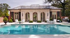 The pool house was built as a self-contained entertaining space separate from the main house - Traditional Home