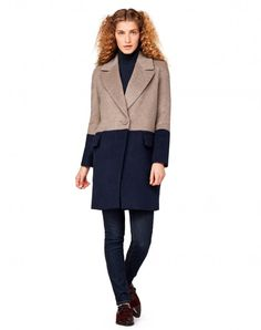 Long coat in warm and soft wool blend, completely lined in viscose blend fabric. It has long sleeves, lapel collar, front opening closed with two maxi buttons with tone-on-tone fabric cover and two pockets with flaps at the sides. The particularity of this garment is in the color block dye: the bottom of the coat and sleeves clashes with the primary color of the garment.