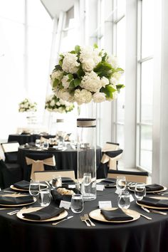Black and Gold Wedding Reception. Tall Centerpieces of White Roses and Hydrangeas