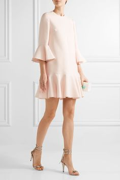 VALENTINO Fluted wool and silk-blend mini dress $2,890 Valentino's shift dress is defined by a dropped waist and fluted cuffs and hem. This ladylike style is cut from structured wool and silk-blend to beautifully hold it's shape. Complement the pretty pastel-pink hue with gold sandals. Shown here with: Edie Parker Clutch, Chloé Sandals, Chan Luu Ring, Cornelia Webb Ring.