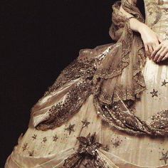 She wanted nothing of what he gave her, wearing the dresses out of duty rather than delight.