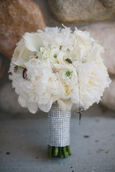 White Bridal Bouquet, Peonies, Roses, Calla Lilies, ranunculus, Bling Wrap, Romantic with rosary and charms.  Classic Bridal Style Round.  Jasmine Galleria Chicagoland Floral and Decor