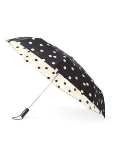 when was the last time you actually wished for rain? you'll be hoping for afternoon showers just so this deco dot umbrella can get some exposure. we love how it earns its place as a stylish accessory, you'll love how it will keep a rain-soaked bad hair day at bay.