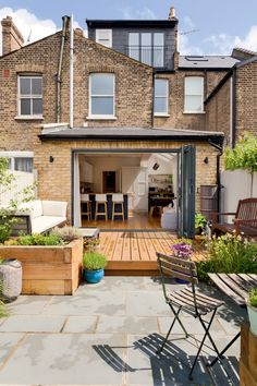 This rundown terraced house in London is now a stylish, modern city home thanks to an open-plan extension and loft conversion Kitchen Extension Terraced House, House Extension Design, House Design, Roof Extension, Terrace House Exterior, Victorian Terrace House, House Plans Uk, Modern House Plans, Terraced House Loft Conversion