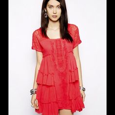 """Free People Coral Sunbeam Dress HP 11/21/15 Dress is a beautiful coral shape with lots of details. It is 31"""" long. The neckline has an unfinished look. NWOT Free People Dresses"""