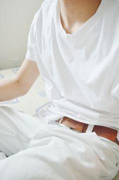 classy, clean, elegant - loose white v neck shirt + brown leather skinny belt + slouchy white slacks