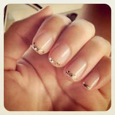 glitter french mani... LOVE this. I have some gold glitter nail polish, but it's a bit much for the office on the whole nail.. this is the perfect solution! great idea