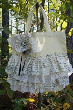 This bag has frills, words, and lace. That's a good percentage of my favorite things. If only there was some pink...