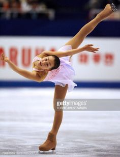 Tokyo, JAPAN: Japanese skater Mao Asada performs during the women's singles short program at the World Figure Skating Championships 2007 in Tokyo, 23 March 2007. Asada scored 61.32 points to clinch the fifth position of the competition. AFP PHOTO / TOSHIFUMI KITAMURA (Photo credit should read TOSHIFUMI KITAMURA/AFP/Getty Images)