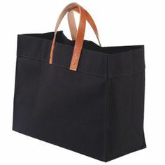 "Perfect for trips to the beach or farmers' market visits, this classic canvas tote showcases leather handles and ample storage space.      Product: ToteConstruction Material: Canvas and leatherColor: Black Features: Ample storage spaceDimensions: 14"" H x 18"" W x 8.25"" DCleaning and Care: Machine wash and lay flat to dry"