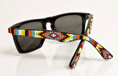 The Mosley Tribes x Oliver Peoples shades hand-beaded by designer Jenny Dayco.-- I don't like the design but love the concept of beaded sunglasses! Cheap Ray Bans, Cheap Ray Ban Sunglasses, Sunglasses 2016, Clubmaster Sunglasses, Stylish Sunglasses, Sports Sunglasses, Oliver Peoples, Navajo Print, Ray Ban Wayfarer