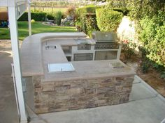 Landscaping Ideas & Garden Ideas > Outdoor Kitchens: Cooking Up Some Ideas