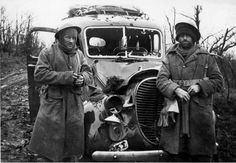 A lucky escape. William Crawley (left) and Phillip Tritt from 27th (Machine Gun) Battalion alongside their bullet-ridden truck in Greece, April 1941. The pair had been near Grevena when they were attacked by German aircraft. German air superiority over Crete meant that Allied vehicles were equally vulnerable during the battle for that island in May.  Lance-Sergeant Tritt was killed in action in North Africa on 4 September 1942.