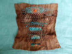 Walnut dyed wool felt by Elizabeth Bunsen