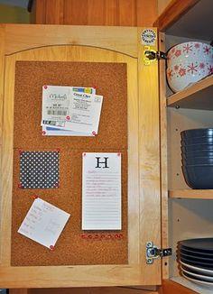 Cork board inside a cabinet = clean refrigerator door.