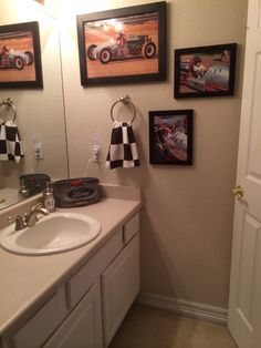 Teen boy bathroom. Vintage Race Car theme. Checkered flag towel, Ford silverware holder for toothbrushes, deodorant and toothpaste. #81 sticker on soap dispenser, which was grandpa's vintage race car number.