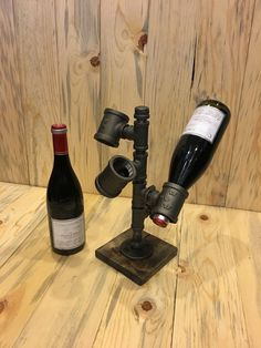 Black Iron Pipe Industrial-Style Wine Rack by CreatedByDiDesign