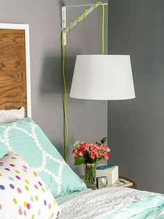 If you can screw in a light bulb and drill a few holes, you can make a hanging bedside lamp like Carrie of Dream Green DIY. Decidedly modern with a neon green cord, this updated wall sconce is the perfect solution for bedrooms with small nightstands. Bedroom Lamps, Bedroom Lighting, Bedroom Decor, Budget Bedroom, Hanging Light In Bedroom, Ikea Hanging Light, Modern Bedroom, Bedroom Night, Hanging Lamps