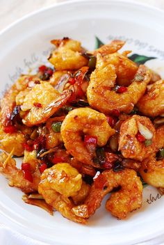 Kkanpung Saeu (Sweet and Spicy Shrimp) Kkanpung Shrimp is a deep-fried shrimp dish glazed in a sweet, slightly sour and spicy sauce. It's a popular Korean-Chinese dish that can be easily made at home! Sweet And Spicy Shrimp, Spicy Shrimp Recipes, Sweet And Spicy Sauce, Fish Recipes, Seafood Recipes, Asian Recipes, Cooking Recipes, Ethnic Recipes, Korean Shrimp Recipe