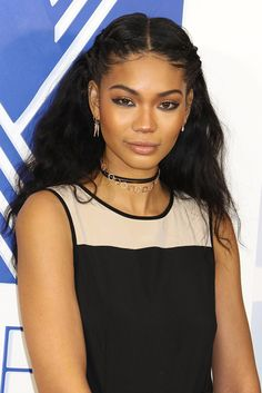 What do you when you have chokers and you can't decide which one to wear? Layer them! Chanel Iman took her accessories to the next level with contrasting earrings and necklaces.