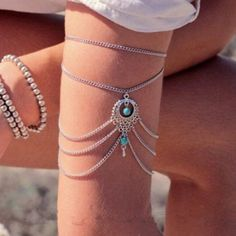"""Boho Turquoise Silver Arm Cuff New in package (no tags). silver bohemian summer style arm cuff with turquoise beads! Price is for one arm cuff. 9 1/2"""" chain with a 2"""" extender. Can also be worn as an anklet!(see last pic). Jewelry Bracelets"""
