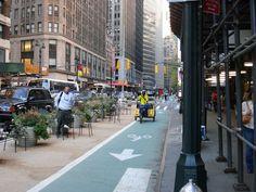 http://www.peopleforbikes.org/blog/entry/tech-talk-19-beautiful-ways-to-protect-bike-lanes-photos