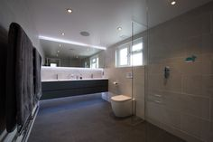 The sizeable bathroom is an unexpected surprise and combines beauty with function. Visitors have particularly loved the contemporary style bathroom, as the combination of having additional space and creating something modern in an old house is refreshing.  #home #property #conversion #loft #loftconversion #mansard #interiordesign #bathroom