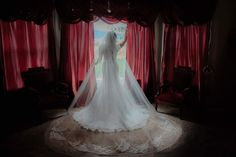 wedding bridal suite red dramatic vintage elegant bride view valley mountain curtains