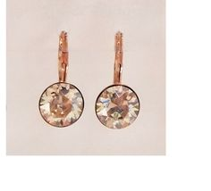 Rose gold drop earrings with silver shade crystal coloured swarovski crystals from Isa Dambeck.