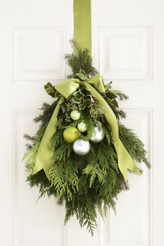 Green Christmas Door Hanging - Bundled together with floral wire, fragrant greenery — yew, holly, spruce, and eucalyptus Noel Christmas, Green Christmas, Christmas Projects, Winter Christmas, Holiday Crafts, Christmas Wreaths, Xmas, Christmas Greenery, Classy Christmas