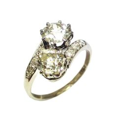 Crossover design vintage diamond engagement ring set with 1.3ct and 1.2ct diamonds, circa 1910. Available at Grays Antique Market, London.